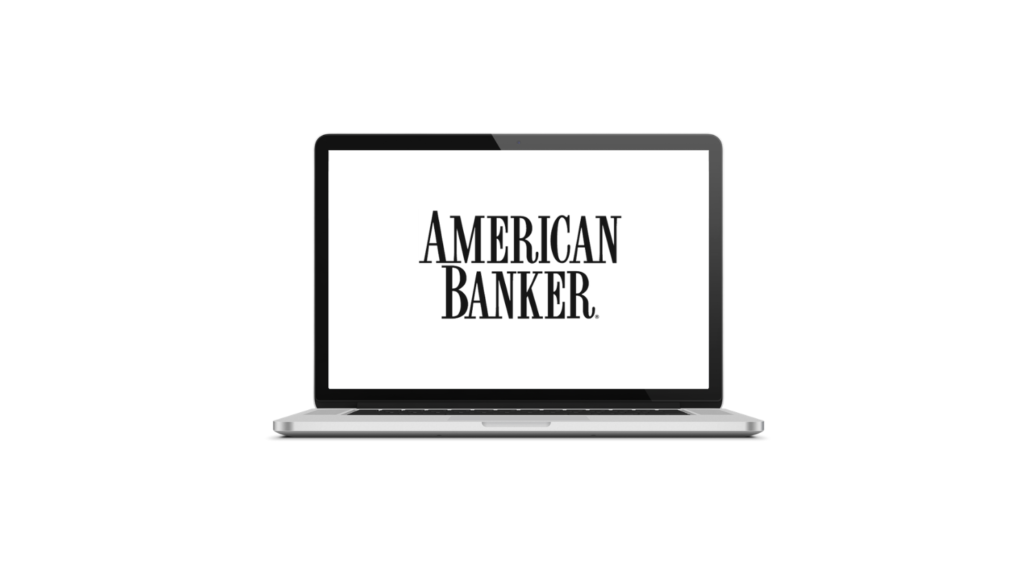 laptop computer with american banker logo on the screen